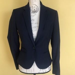 Navy blue blazer.